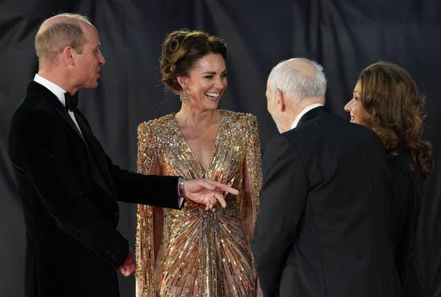 The Duke and Duchess of Cambridge are greeted by Barbara Broccoli (right) and Michael G. Wilson (second right)  (Jonathan Brady/PA)