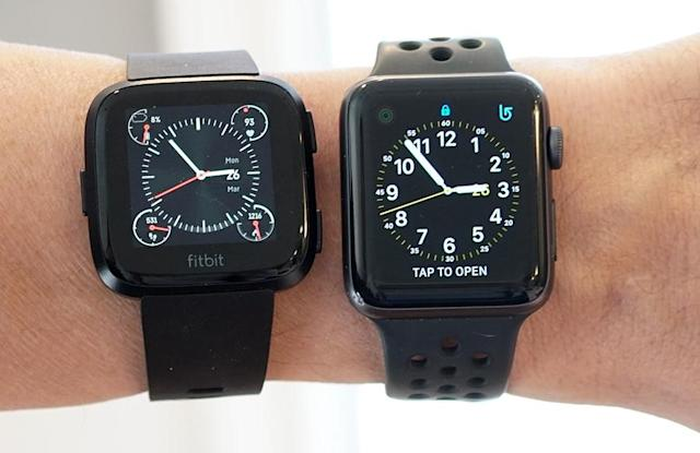 The Versa (left) is slightly wider, but shorter, than the 42mm Apple Watch.