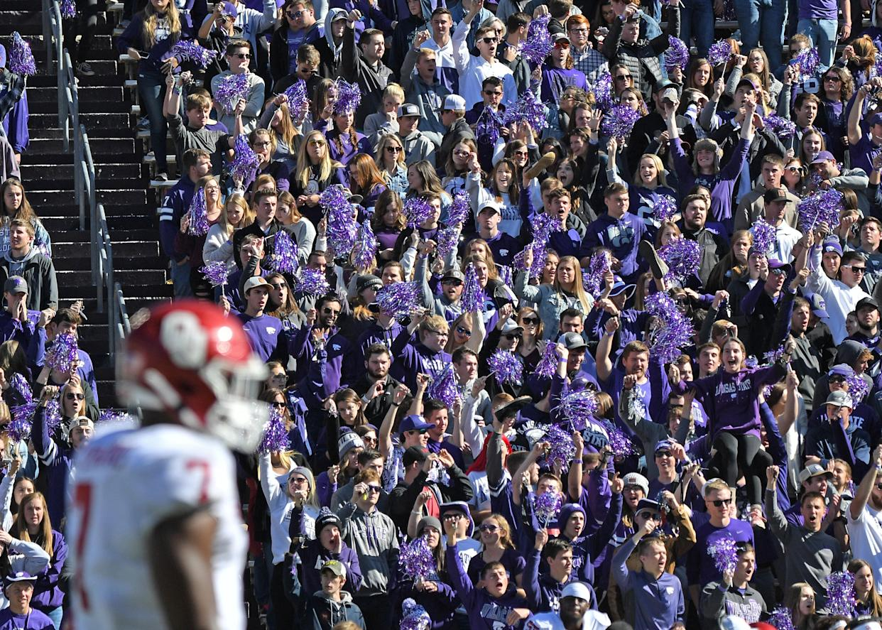 MANHATTAN, KS - OCTOBER 26:  Kansas State Wildcats fans cheer before a kick-off against the Oklahoma Sooners during the second half at Bill Snyder Family Football Stadium on October 26, 2019 in Manhattan, Kansas. (Photo by Peter G. Aiken/Getty Images)