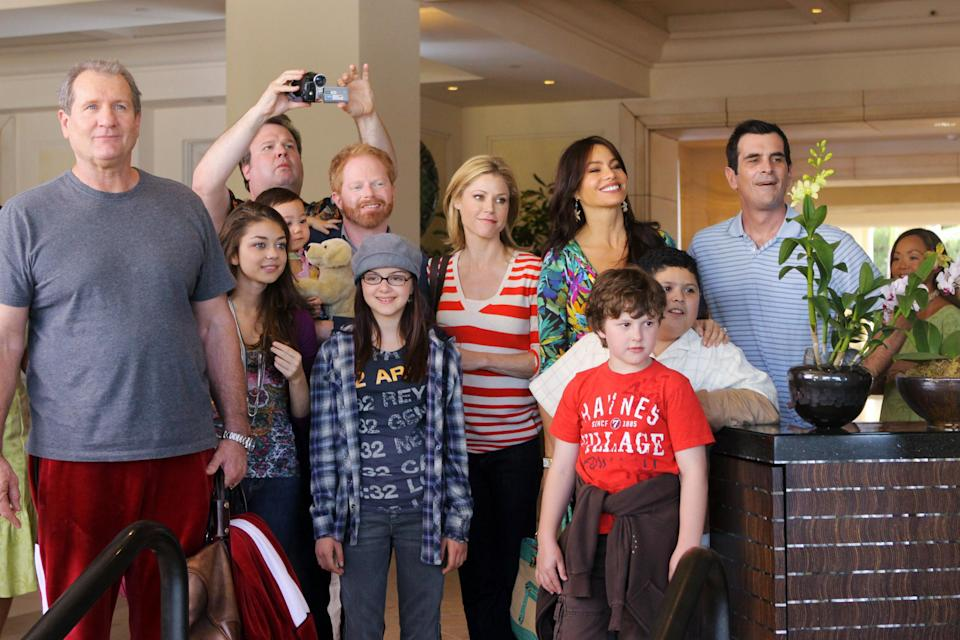 The entire cast of Modern Family huddled together in a waiting room