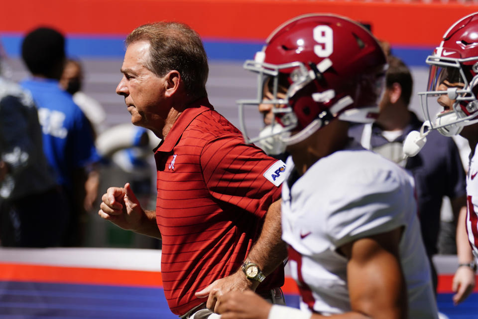 Alabama head coach Nick Saban runs onto the field with his team before the start of an NCAA college football game against Miami, Saturday, Sept. 4, 2021, in Atlanta. (AP Photo/John Bazemore)