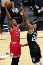 Chicago Bulls center Wendell Carter Jr., left, shoots against Sacramento Kings center Hassan Whiteside during the first half of an NBA basketball game in Chicago, Saturday, Feb. 20, 2021. (AP Photo/Nam Y. Huh)