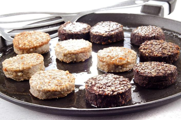 white pudding and black pudding on a plate