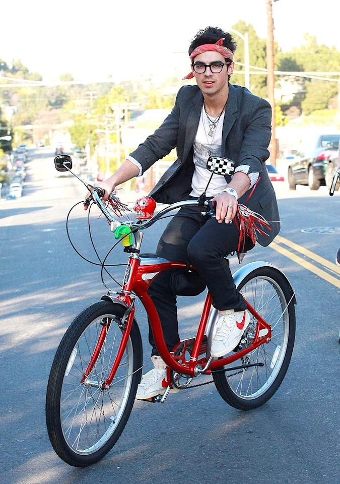 "Dear Joe Jonas, you're a handsome, quasi-talented, Disney-manufactured pop star. Why then must you try so hard to look like a hipster? You aren't fooling anyone. <a href=""http://www.splashnewsonline.com"" target=""new"">Splash News</a> - February 8, 2010"