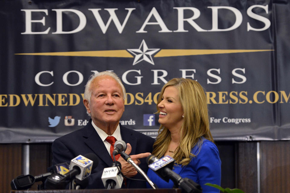 FILE - Louisiana congressional candidate former Louisiana Gov. Edwin Edwards, joined with his wife Trina Edwards, addresses the crowd during his election watch party in Baton Rouge, La., in this Tuesday, Nov. 4, 2014, file photo. Edwin Washington Edwards, the high-living four-term governor whose three-decade dominance of Louisiana politics was all but overshadowed by scandal and an eight-year federal prison stretch, died Monday, July 12, 2021 . He was 93. Edwards died of respiratory problems with family and friends by his bedside, family spokesman Leo Honeycutt said. He had suffered bouts of ill health in recent years and entered hospice care this month at his home in Gonzales, near the Louisiana capital.(AP Photo/Bill Feig, File)