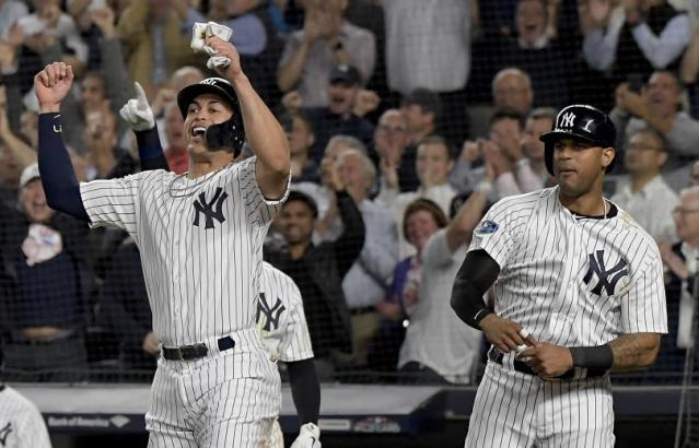 Giancarlo Stanton made a mark in his anticipated postseason debut. (AP)