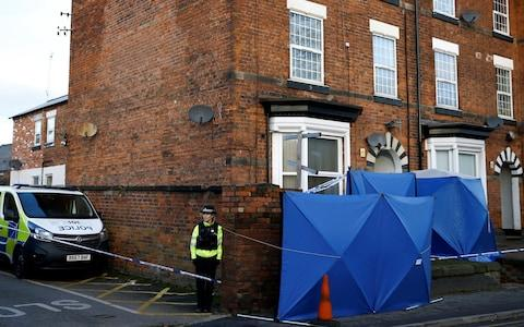 A police officer stands next to forensic tents outside a property, which was searched in connection with stabbing on London Bridge, in Stafford - Credit: Reuters