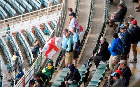 England cricket supporters wait in the stands for the match to start after rain has delayed play during the first day of the fourth Test cricket match between South Africa and England at the Wanderers Stadium in Johannesburg on January 24, 2020. - Credit: Getty Images