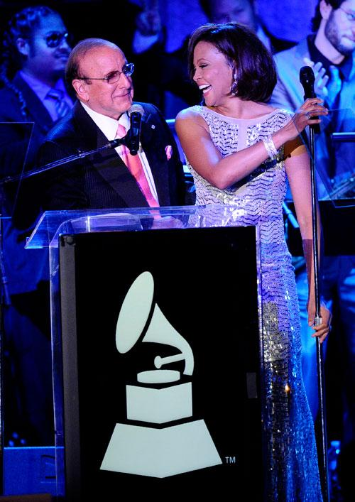 Producer Clive Davis (L) and singer Whitney Houston speak onstage at the 2011 Pre-GRAMMY Gala and Salute To Industry Icons Honoring David Geffen at Beverly Hilton on February 12, 2011 in Beverly Hills, California.