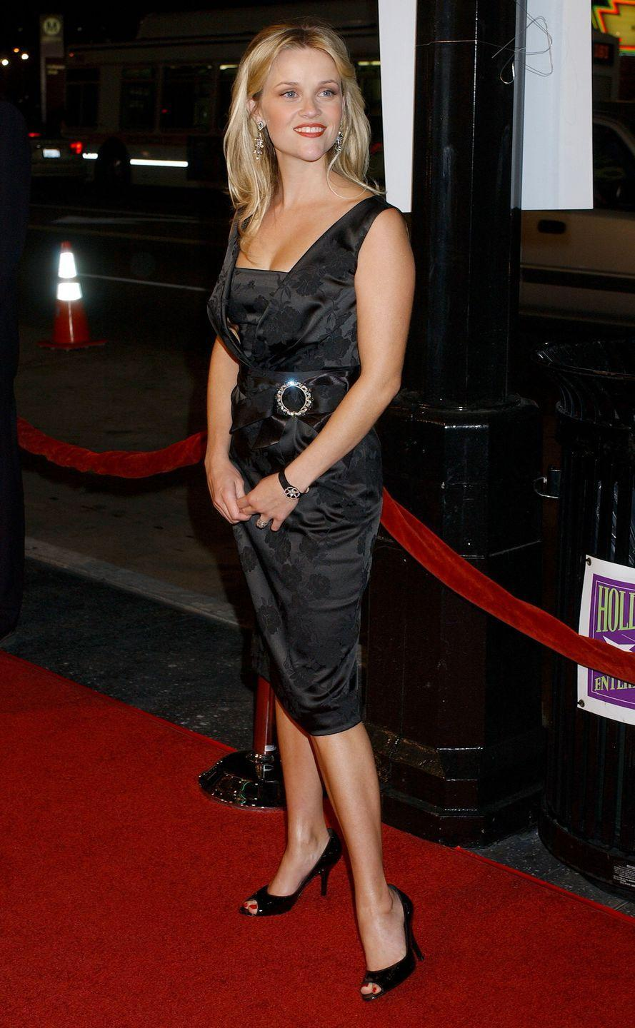 <p>WItherspoon kept it sleek at her next premiere in a black LBD with embellished belt. </p>