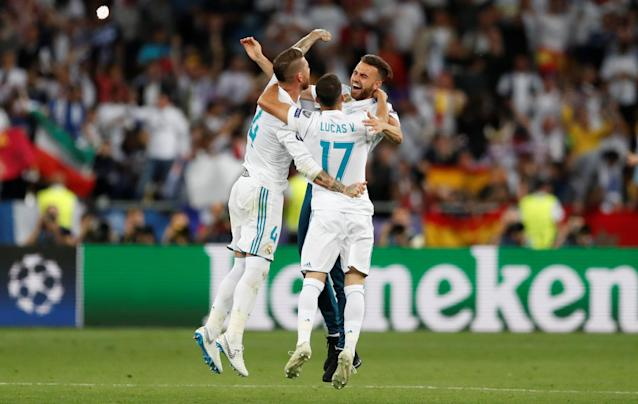 Soccer Football - Champions League Final - Real Madrid v Liverpool - NSC Olympic Stadium, Kiev, Ukraine - May 26, 2018 Real Madrid's Sergio Ramos and Lucas Vazquez celebrate winning the champions league at the end of the match REUTERS/Andrew Boyers