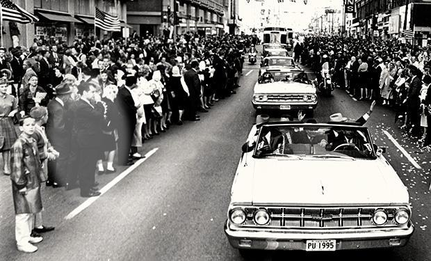 """<b class=""""credit"""">Courtesy of Bob Huffaker</b>Bob Huffaker is pictured left next to the motorcade on Nov. 22, 1963."""