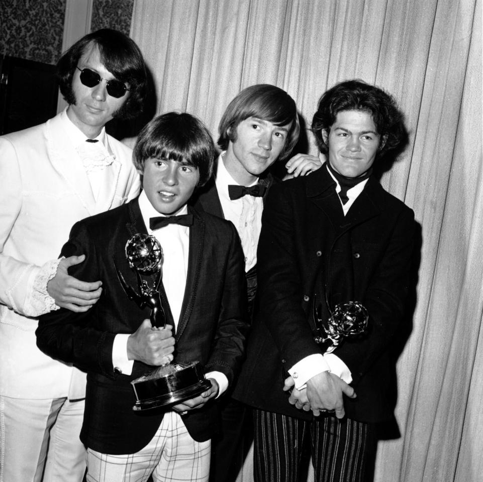 In this June 4, 1967 file photo, The Monkees, from left: Mike Nesmith, Davy Jones, Peter Tork and Micky Dolenz pose with their Emmy award at the 19th Annual Primetime Emmy Awards in Calif. Peter Tork said Thursday, March 5, 2009 that he has a rare form of head and neck cancer, but the prognosis is good.  (AP Photo)