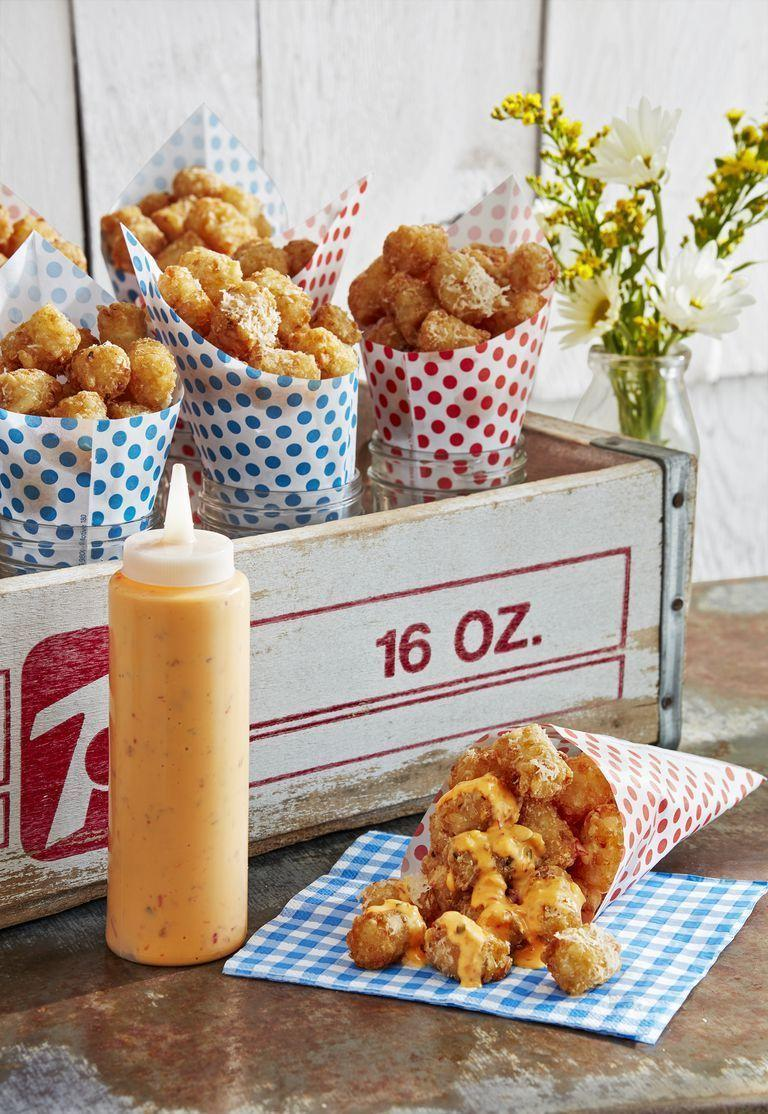 """<p>An appetizer to please kids and adults alike! Store-bought tots get tossed with Parmesan and garlic powder. Serve with a sweet chili dipping sauce and watch them disappear almost immediately.</p><p><strong><a href=""""https://www.countryliving.com/food-drinks/a27546024/parmesan-tots-with-dipping-sauce-recipe/"""" rel=""""nofollow noopener"""" target=""""_blank"""" data-ylk=""""slk:Get the recipe"""" class=""""link rapid-noclick-resp"""">Get the recipe</a>.</strong></p>"""