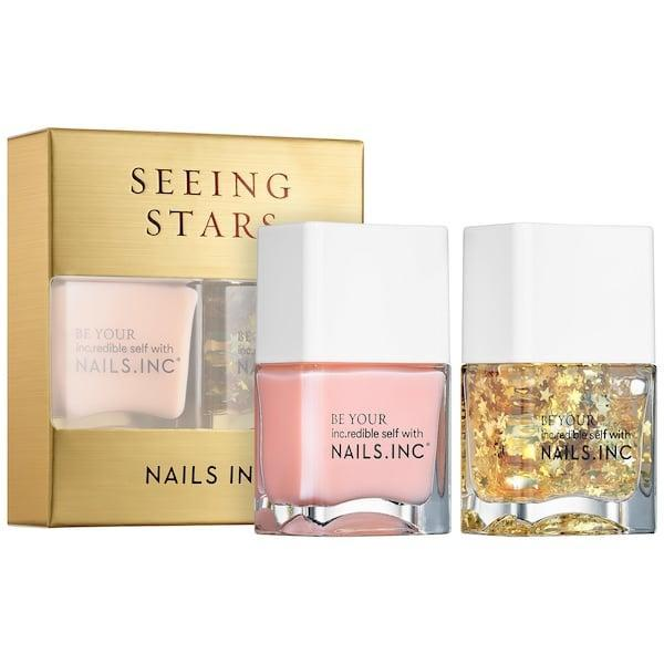 <p>The starry polish in this <span>Nails Inc. Seeing Stars Nail Duo</span> ($11, originally $15) adds a clear coat and gold stars to any color, including the glossy pink also inside.</p>