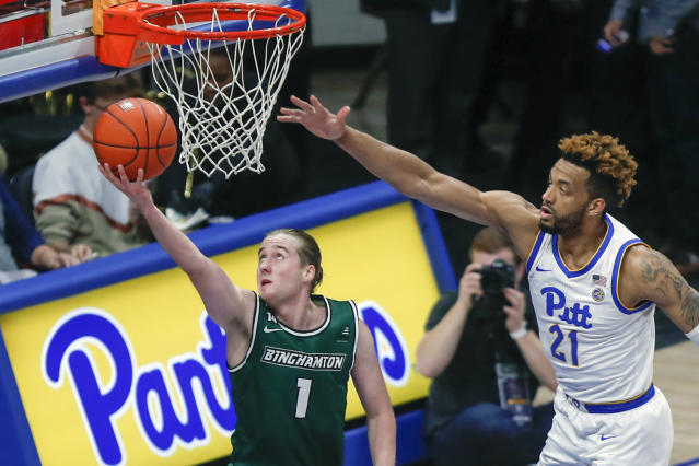 FILE - In this Dec. 20, 2019, file photo, Binghamton's Hakon Hjalmarsson (1), of Iceland, shoots as Pittsburgh's Terrell Brown (21) defends during the second half of an NCAA college basketball game in Pittsburgh. Hjalmarsson is just starting his American basketball experience and trying to find his role at Binghamton. (AP Photo/Keith Srakocic, File)