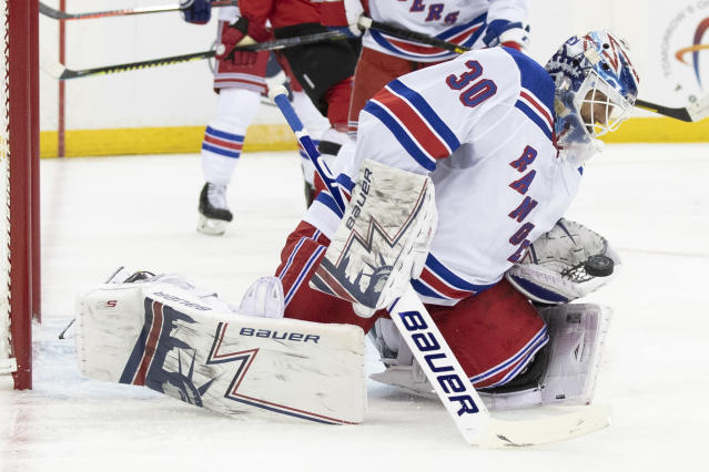 New York Rangers goaltender Henrik Lundqvist makes a save during the second period of the team's preseason NHL hockey game against the New Jersey Devils, Friday, Sept. 20, 2019, in Newark, N.J. (AP Photo/Mary Altaffer)