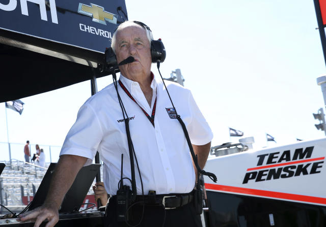 FILE - In this Sept. 3, 2016, file photo, team owner Roger Penske watches from the pits during practice for the IndyCar Grand Prix at The Glen auto race, in Watkins Glen, N.Y. Indianapolis Motor Speedway and the IndyCar Series have been sold to Penske Entertainment Corp. in a stunning announcement that relinquishes control of the iconic speedway from the Hulman family after 74 years. (AP Photo/Mel Evans, File)