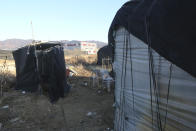 An outdoor toilet, left, is placed beside a dormitory for migrant workers at a farm in Pocheon, South Korea on Feb. 8, 2021. Workers often are crammed in shipping containers or flimsy, poorly ventilated huts. (AP Photo/Ahn Young-joon)