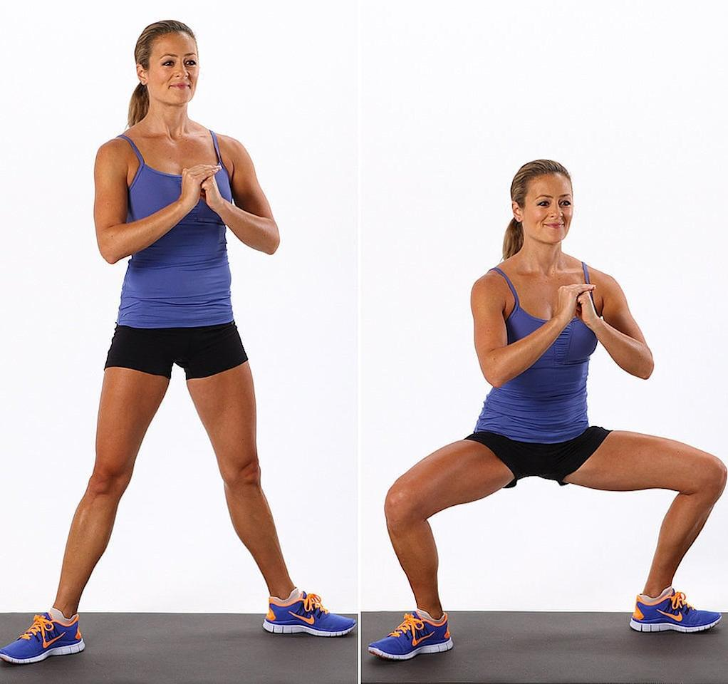"""<ul> <li>Start with feet wider than hip distance and toes facing opposite directions. Keeping your weight in your heels, lower yourself down into a deep <a href=""""http://www.popsugar.com/fitness/photo-gallery/36123288/image/36123503/Sumo-Squat"""" class=""""ga-track"""" data-ga-category=""""Related"""" data-ga-label=""""http://www.popsugar.com/fitness/photo-gallery/36123288/image/36123503/Sumo-Squat"""" data-ga-action=""""In-Line Links"""">sumo squat</a>. Add a couple of pulses to the bottom of your squat before you slowly stand up, keeping your back straight. </li> <li>As you come to the top of the squat, transfer weight from your heels to your toes and slowly rise up into a <a href=""""http://www.popsugar.com/fitness/photo-gallery/31081972/image/31081978/Calf-Raises-Basic"""" class=""""ga-track"""" data-ga-category=""""Related"""" data-ga-label=""""http://www.popsugar.com/fitness/photo-gallery/31081972/image/31081978/Calf-Raises-Basic"""" data-ga-action=""""In-Line Links"""">calf raise</a> (keeping feet in sumo squat stance). Squeeze calves the entire time and try to balance on your toes for at least five seconds. </li> <li>Slowly bring yourself down from the calf raise and immediately go back into a <a href=""""http://www.popsugar.com/fitness/photo-gallery/36123288/image/36123503/Sumo-Squat"""" class=""""ga-track"""" data-ga-category=""""Related"""" data-ga-label=""""http://www.popsugar.com/fitness/photo-gallery/36123288/image/36123503/Sumo-Squat"""" data-ga-action=""""In-Line Links"""">sumo squat</a>. </li> <li>Repeat each move 10 times each for one complete circuit. Perform the circuit twice.</li> </ul>"""