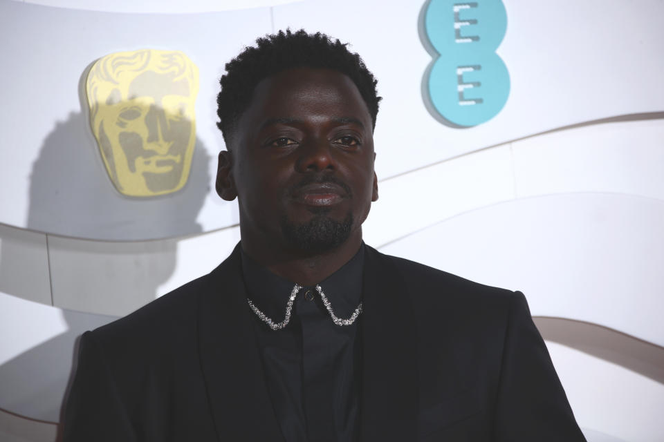 Daniel Kaluuya poses for photographers upon arrival at the Bafta Film Awards, in central London, Sunday, Feb. 2 2020. (Photo by Joel C Ryan/Invision/AP)