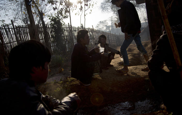 """In this Jan 28 photo, young drug addicts gather outdoors for morning tea at a drug rehabilitation center run by the Kachin Baptist Community at Nampatka Village, Northern Shan State, Myanmar. """"Every family is affected,"""" said Yaw Htung, Nampakta's village administrator. """"Half the population of 8,000 uses. It's not just opium or heroin anymore, but methamphetamines."""" (AP Photo/Gemunu Amarasinghe)"""