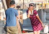 <p>Pom Klementieff strikes a pose as <i>Mission: Impossible</i> costar Simon Pegg snaps a photo in Venice on Monday. </p>