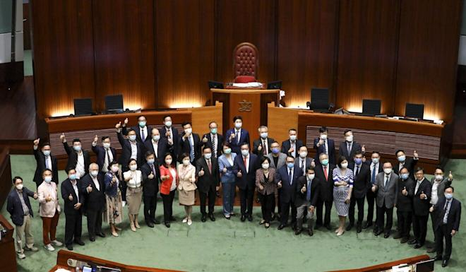 Pro-establishment lawmakers pose for the end-of-year photo at Legco. Photo: Dickson Lee