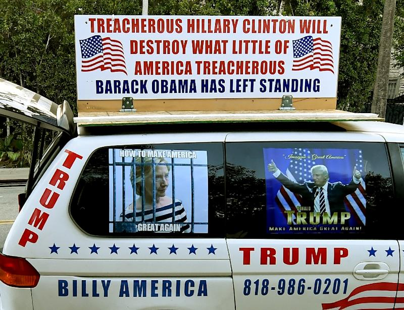 A vehicle belonging to Donald Trump supporters is parked near a house where presidential hopeful Hillary Clinton is holding a fundraiser, in Beverly Hills, California, on October 13, 2016