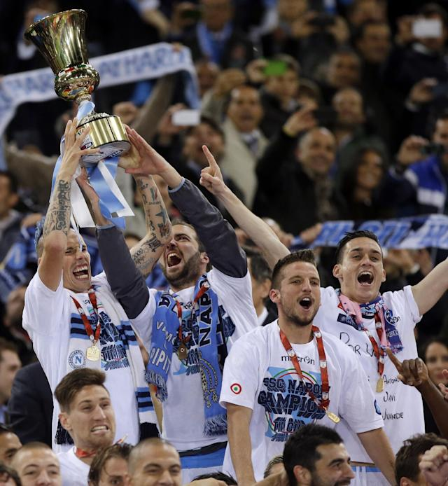 Napoli's Marek Hamsik, left, holds up the trophy as he celebrates with teammates after winning the Italian Cup final match between Fiorentina and Napoli in Rome's Olympic stadium Saturday, May 3, 2014. Fiorentina won 3-1. (AP Photo/Gregorio Borgia)