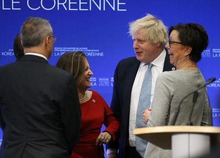 Canada's Minister of Foreign Affairs Chrystia Freeland talks with Britian's Secretary of State for Foreign Affairs Boris Johnson during the Foreign Ministers' Meeting on Security and Stability on the Korean Peninsula in Vancouver, British Columbia, Canada January 16, 2018. REUTERS/Ben Nelms