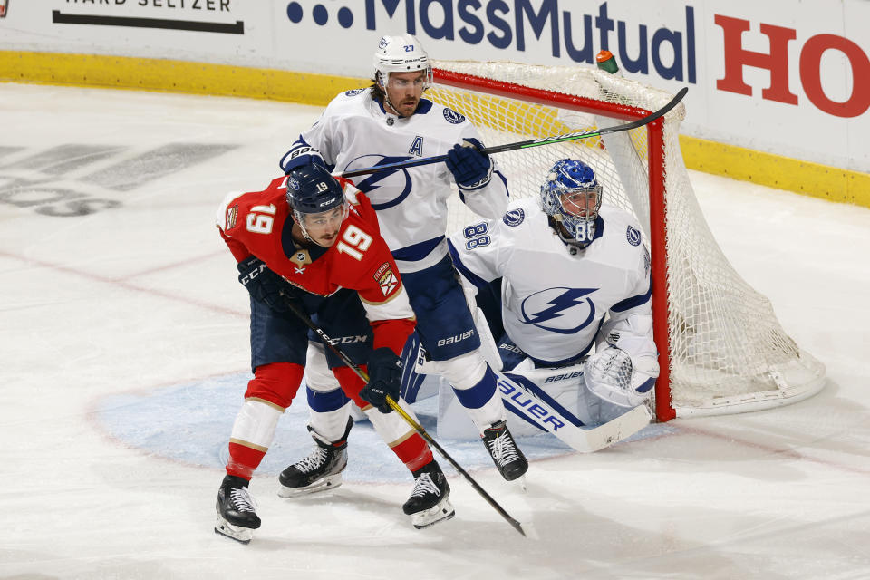 Tampa Bay Lightning defenseman Ryan McDonagh (27) defends against Florida Panthers left wing Mason Marchment (19) in front of Tampa Bay Lightning goaltender Andrei Vasilevskiy (88) during the second period in Game 1 of an NHL hockey Stanley Cup first-round playoff series, Sunday, May 16, 2021, in Sunrise, Fla. (AP Photo/Joel Auerbach)