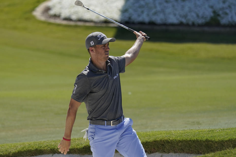Justin Thomas reacts after a near birdie chip shot on the 18th hole during the third round of the Charles Schwab Challenge golf tournament at the Colonial Country Club in Fort Worth, Texas, Saturday, June 13, 2020. (AP Photo/David J. Phillip)