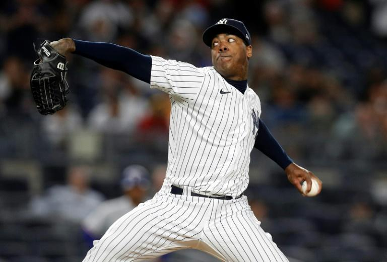 New York Yankees pitcher Aroldis Chapman is another Cuban player who defected to pursue a career in the Major Leagues (AFP/Jim McIsaac)