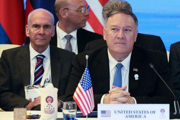 PHOTO: Former senior advisor Michael McKinley, left, sits behind Secretary of State Mike Pompeo during the ASEAN Foreign Ministers' Meeting in Bangkok, Thailand, Aug. 1, 2019. (Jonathan Ernst/Pool via Reuters)