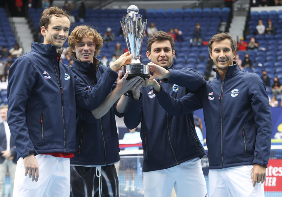 Russia's ATP Cup winners Daniil Medvedev, Andrey Rublev, Aslan Karatsev and Evgeny Donsky pose with their trophy after defeating Italy in the final in Melbourne, Australia, Sunday, Feb. 7, 2021.(AP Photo/Hamish Blair)