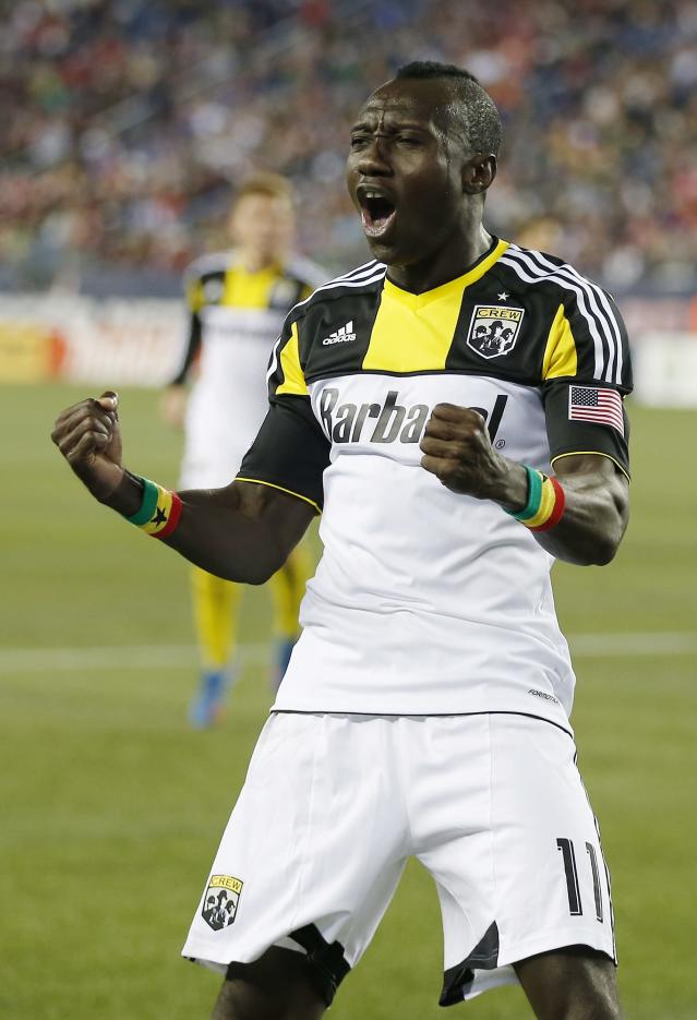 Columbus Crew's Dominic Oduro (11) celebrates his goal in the second half of an MLS soccer game against the New England Revolution in Foxborough, Mass., Saturday, Oct. 19, 2013. (AP Photo/Michael Dwyer)