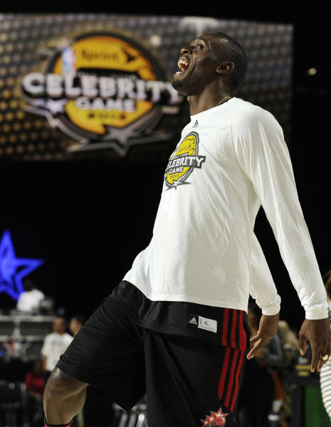 Olympic gold medalist track athlete Usain Boltm of Jamaica, warms up before the NBA All-Star celebrity basketball game, Friday, Feb. 15, 2013, in Houston. (AP Photo/Pat Sullivan)