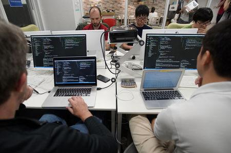Students attend Code Chrysalis, a software-coding boot camp, at a basement room in Tokyo