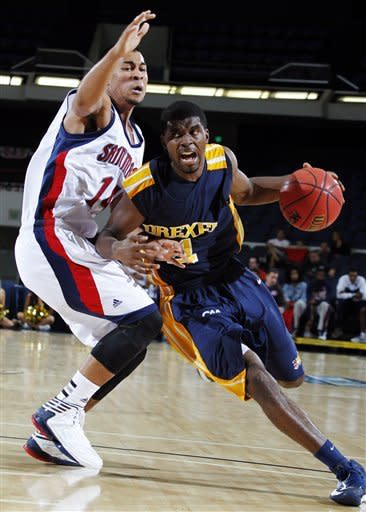 Drexel guard Frantz Massenat, right, drives to the basket against Saint Mary's guard Stephen Holt (14) during the second half of their NCAA college basketball game in the first round of the DirecTV Classic in Anaheim, Calif., Thursday, Nov. 22, 2012. Saint Mary's won 76-64. (AP Photo/Alex Gallardo)