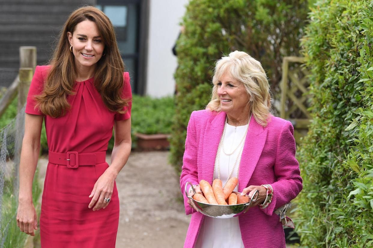 Britain's Catherine, Duchess of Cambridge talks with US First Lady Jill Biden as she carries carrots to feed a pet rabbit during their visit to Connor Downs Academy in Hayle, Cornwall on the sidelines of the G7 summit on June 11, 2021. (Photo by DANIEL LEAL-OLIVAS / various sources / AFP) (Photo by DANIEL LEAL-OLIVAS/AFP via Getty Images)