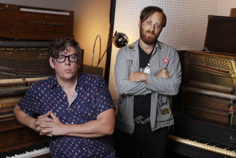 """In this Aug. 19, 2019, photo, Patrick Carney, left, and Dan Auerbach of The Black Keys pose for a portrait in Nashville, Tenn. The Grammy-winning duo back with their ninth record called """"Let's Rock,"""" and a new tour starting Sept. 19 in Los Angeles. (AP Photo/Mark Humphrey)"""