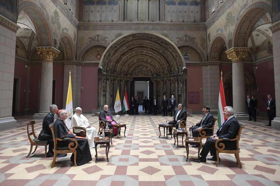 Pope Francis, left, meets Hungarian President Janos Ader, second from right, and Prime Minister Viktor Orban, third from right, at Budapest's Museum of Fine Arts, Sunday, Sept. 12, 2021. Francis is opening his first foreign trip since undergoing major intestinal surgery in July, embarking on an intense, four-day, two-nation trip to Hungary and Slovakia that he has admitted might be overdoing it. (Vatican Media via AP)