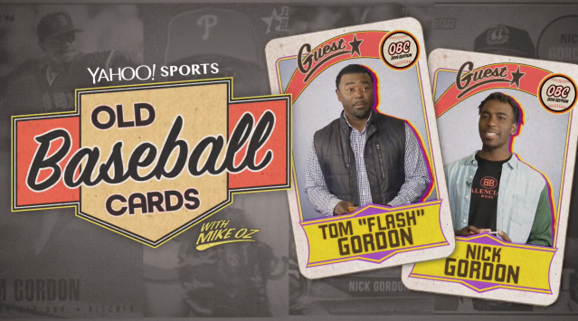 Ex-MLB pitcher Tom Gordon and his son, Twins prospect Nick Gordon, open backs of baseball cards. (Yahoo Sports)