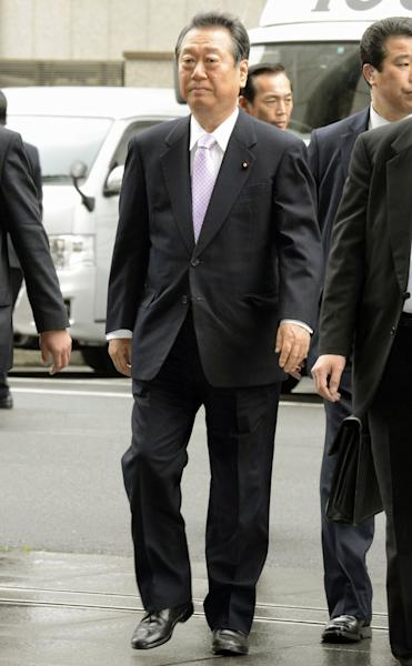 Ichiro Ozawa, a powerbroker of the ruling Democratic Party of Japan, arrives at the Tokyo District Court in Tokyo Thursday, April 26, 2012. The court acquitted the veteran lawmaker Thursday in a political funding scandal. Ozawa was charged last year with overseeing false accounting by his former aides in a murky 2004 land deal. (AP Photo/Kyodo News) JAPAN OUT, MANDATORY CREDIT, NO LICENSING IN CHINA, HONG KONG, JAPAN, SOUTH KOREA AND FRANCE