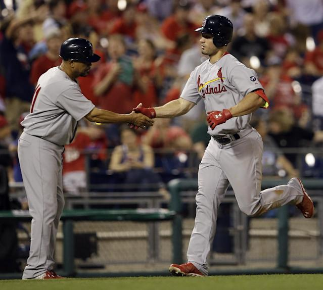 St. Louis Cardinals' Randal Grichuk, right, greets third base coach Jose Oquendo as Grichuk rounds the bases after hitting a home run off Philadelphia Phillies relief pitcher Justin De Fratus during the sixth inning of a baseball game, Friday, June 19, 2015, in Philadelphia. St. Louis won 12-4. (AP Photo/Matt Slocum)