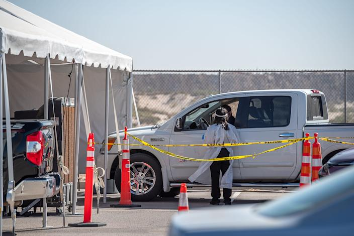 More than 200 vehicles lined up for drive-thru COVID-19 testing in far East El Paso, Texas, on Oct. 14. Many of those waiting for testing said they waited for three hours or more to get tested at the mobile test collection site at the Socorro ISD Student Activities Complex.