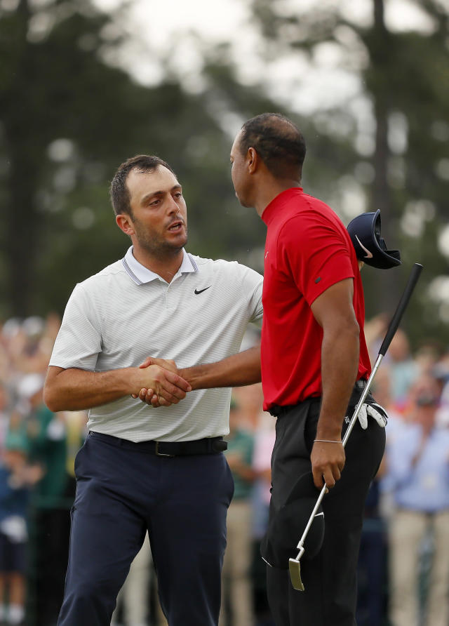 Francesco Molinari of Italy congratulates Tiger Woods of the United States on his win on the 18th green during the final round of the Masters at Augusta National Golf Club on April 14, 2019 in Augusta, Georgia. (Photo by Kevin C. Cox/Getty Images)