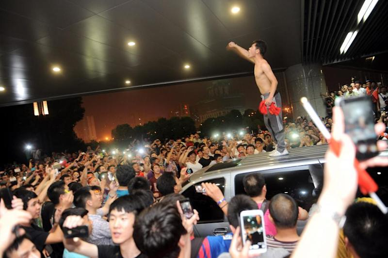 An angry fan of the Chinese national football team after China was defeated 5-1 by Thailand, June 15 2013.