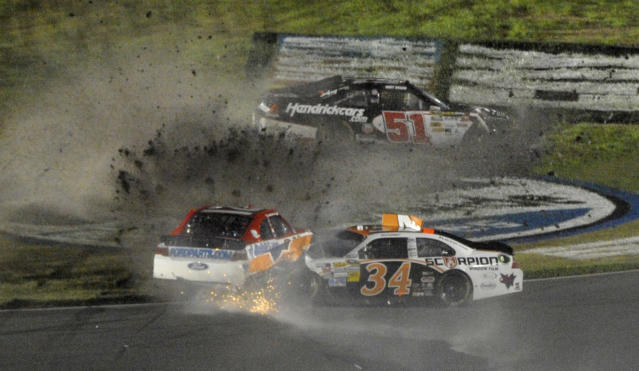 David Ragan (34), Trevor Bayne, left, and Kurt Busch (51) are involved in a wreck during the NASCAR Daytona 500 auto race at Daytona International Speedway in Daytona Beach, Fla., Monday, Feb. 27, 2012. (AP Photo/Phelan M. Ebenhack)